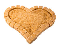 Heart from not refined reed sugar on a white background Stock Image
