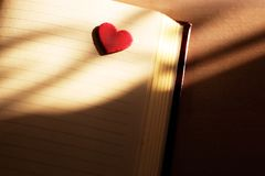 Heart and notebook corner Love shadows background. Red heart on a blank page corner notebook Love letter paper background with heart royalty free stock image