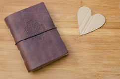 Heart with a notebook Stock Photography