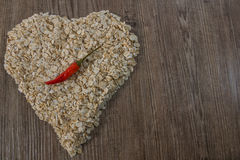Heart of oat flakes Stock Photography