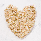 Heart of oat flakes, closeup top view Royalty Free Stock Photography