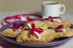 Heart oatmeal cookies with the message. Cookies with a surprise, a love wish. Ovsny cookies are baked with two openings in the middle for a ribbon Royalty Free Stock Photo