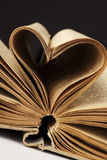 Heart in old book Royalty Free Stock Images