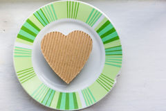 Heart on an old ceramic saucer Stock Photography