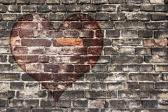 Heart on the old wall Stock Photos