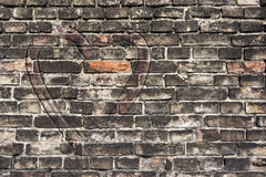Heart on the old wall. Image of the heart on the old broken brick wall Stock Photo