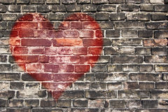 Heart on the old wall. Image of the heart on the old broken brick wall Stock Photography