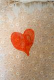 Heart on old wallpaper Stock Photos