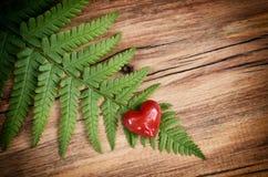 Heart on old wood. Stock Photos