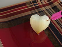 The heart of the onion. Broken arrow and filled with tears royalty free stock images