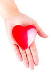 Heart on open palm as love symbol. Heart in hand as love and health symbol over white Royalty Free Stock Photo