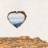Heart opening on the wall Royalty Free Stock Image
