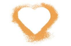 Heart of orange cinnamon isolated on white background Stock Photos