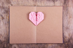 Heart origami and book with blank pages. Pink heart made of paper and diary Stock Images