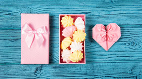Heart of origami and a box of marshmallows. Air merengue and paper heart. Romantic concept. Royalty Free Stock Images