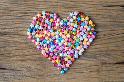Heart from origami star on wood Stock Photos