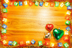 Heart ornament in christmas light frame on golden wooden backgro Royalty Free Stock Photos