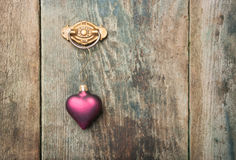 Heart ornament hanging on a barn board Royalty Free Stock Photo