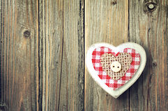 Heart ornament on wooden background Stock Photos