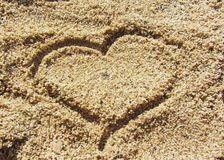 Heart on the sand. A heart outline engraved with a finger on the sand royalty free stock photography