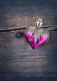 Heart over rustic wooden background (texture). Retro Styled Wallpaper. Royalty Free Stock Images