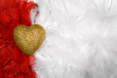 Heart over white and red feathers background Royalty Free Stock Images