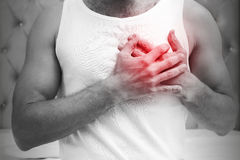 Heart pain gesture. Young sporty man Royalty Free Stock Images