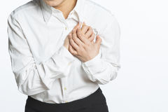 Heart pain and holding her chest Royalty Free Stock Photos