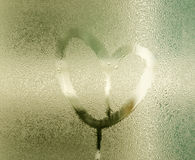 Heart painted on glass with rain drops Royalty Free Stock Images