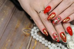 Heart painted on nails. On a beautiful textural background royalty free stock photo