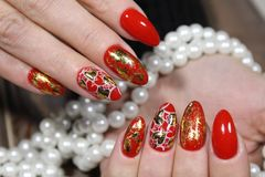 Heart painted on nails. On a beautiful textural background royalty free stock photos