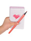 Heart painted in the notebook Stock Photos