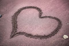 Heart painted on the sand on the beach royalty free stock images
