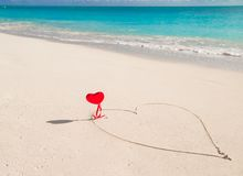 Heart painted in white sand on a tropical beach royalty free stock images