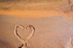 Heart painting on mud Stock Photos