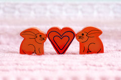 A heart between a pair of hares Royalty Free Stock Photography