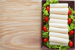 Heart of palm (palmito) with cherry tomato on plate Stock Photos