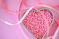 Heart pan with pink beads on polka dots Stock Photography