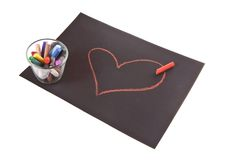 Heart on paper. On white background, hands and chalk Royalty Free Stock Photo