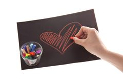 Heart on paper. On white background, hands and chalk Stock Photo
