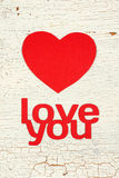 Heart of the paper. And the inscription I love you on old wooden door Stock Photo