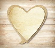 Heart paper speech bubble with shadow on brown Stock Image