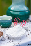 Heart paper stuck to sugar. Heart made of paper stuck to the sugar on the table royalty free stock images