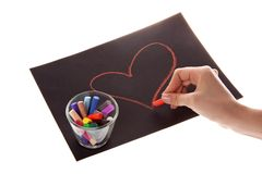 Heart on paper on white background. Hands and chalk Stock Photo