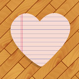 Heart of paper on wood Stock Photos