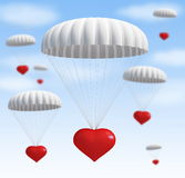 Heart at  parachute. On a sky with clouds Royalty Free Stock Photos