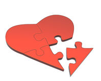 Heart from parts of a puzzle Royalty Free Stock Image