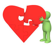 Heart from parts of a puzzle Stock Images