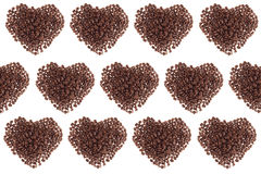Heart pattern of heap roasted coffee beans isolated on white background. Heart pattern heap roasted coffee beans isolated on white background Stock Images
