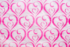 Heart pattern pink crumpled Paper Stock Photo